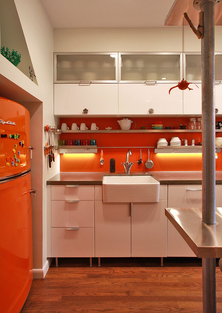 Modern industrial kitchen with brilliant splashes of orange