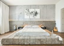 Modern-industrial-style-bedroom-with-concrete-wall-and-platform-bed-217x155
