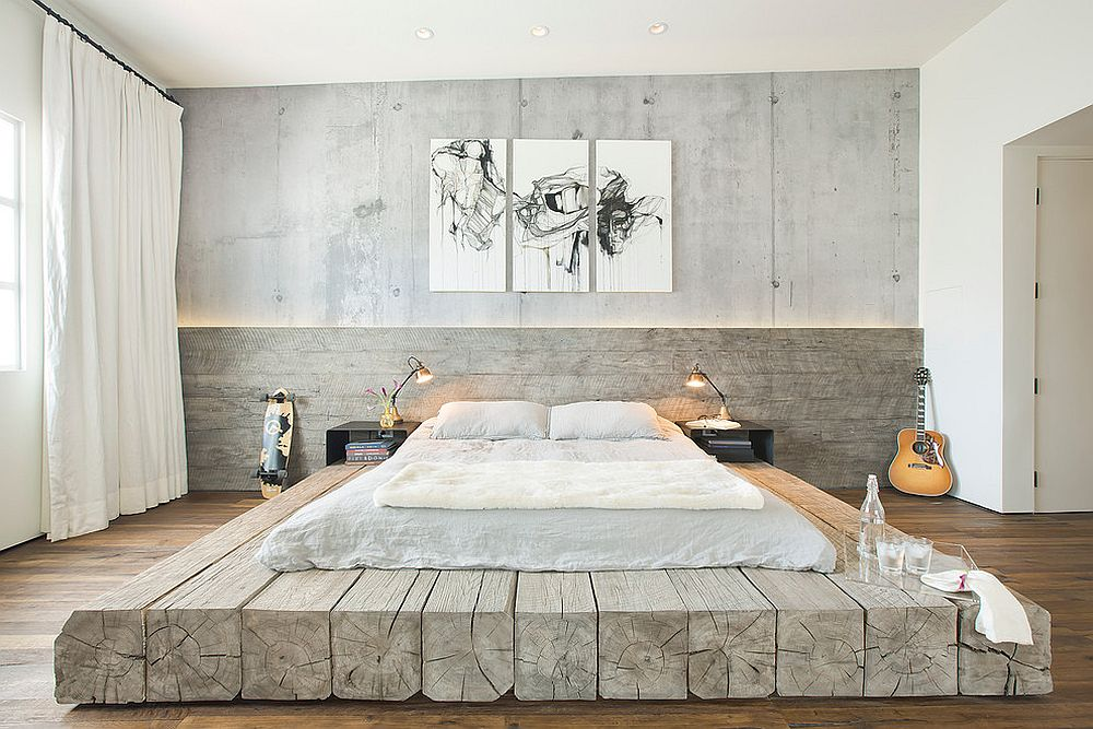 Modern industrial style bedroom with concrete wall and platform bed