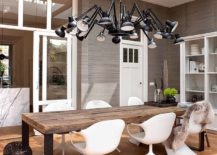 Modern-suspension-light-with-multiple-arms-for-the-double-height-dining-room-217x155