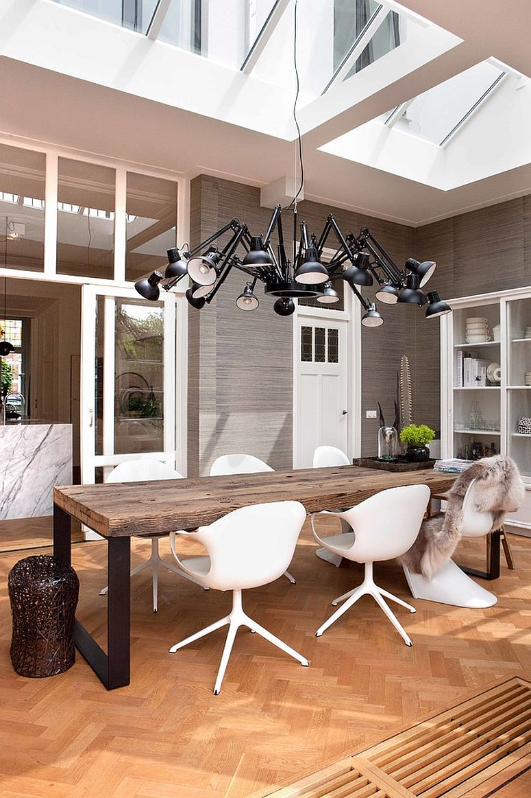 Modern suspension light with multiple arms for the double height dining room