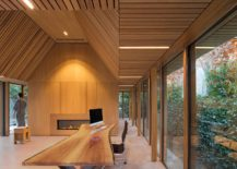 Natural-edge-work-desk-and-an-interior-draped-in-Irok-wood-create-a-cozy-office-217x155
