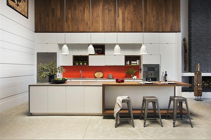 Polished contemporary kitchen in white with orange backsplash