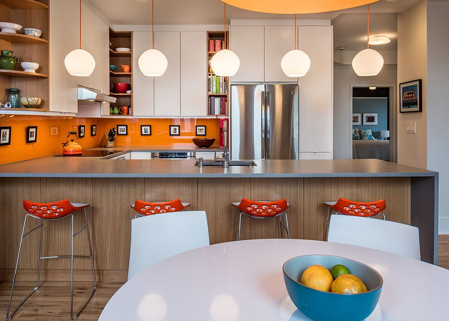 Remodeled contemporary kitchen with a bright orange backsplash