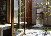 Sheltered-concrete-entrance-to-the-house-217x155