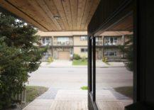 Sheltered-wooden-wlakway-around-the-Hillhurst-Laneway-House-217x155