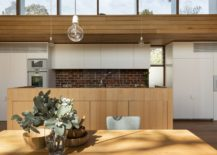 Simple-and-unassuming-lights-for-the-double-height-dining-room-217x155