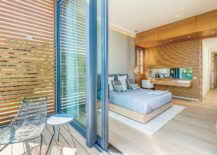 Sliding-glass-doors-connect-the-master-bedroom-with-the-balcony-outside-217x155