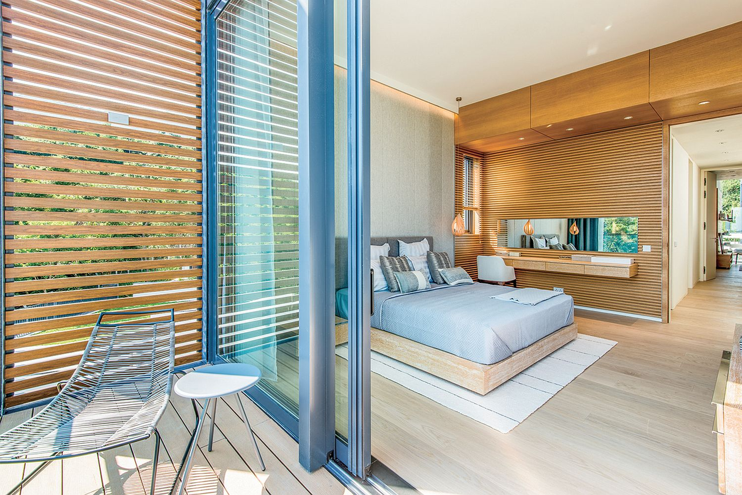 Sliding-glass-doors-connect-the-master-bedroom-with-the-balcony-outside