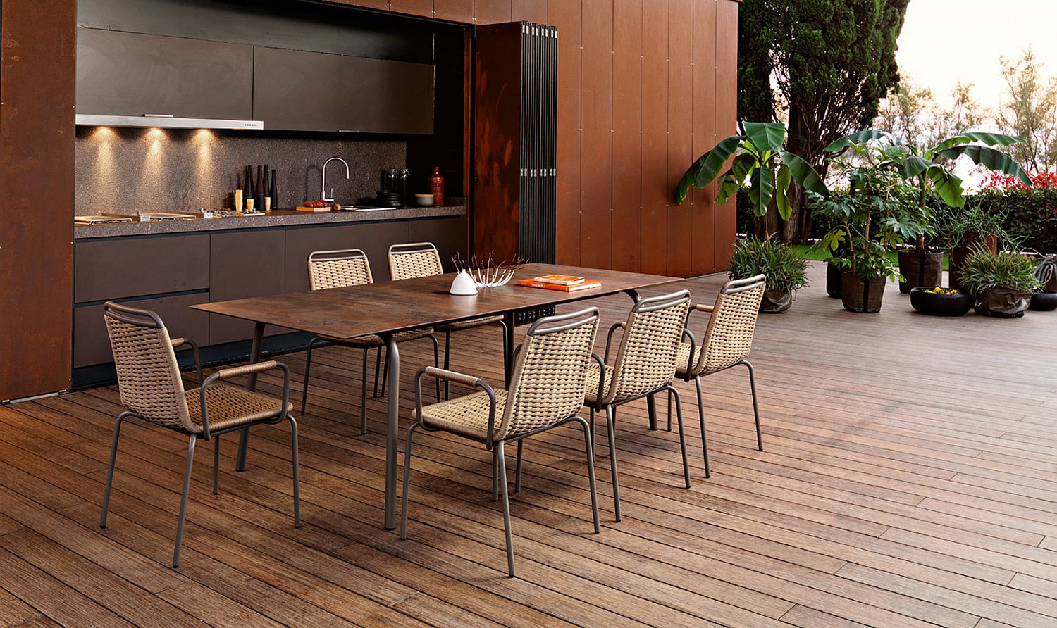 Slim outdoor dining table combined with delightfully woven chairs