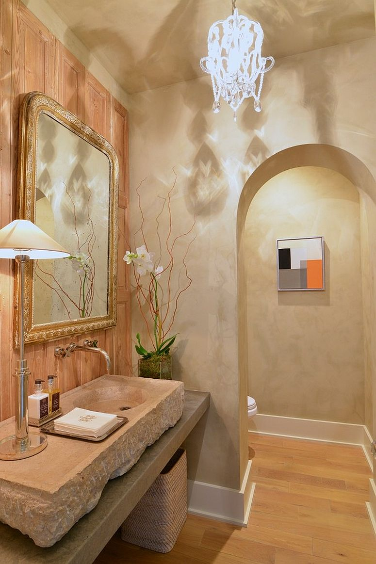 Stone sink and gorgeous chandelier for the modern Mediterranean powder room
