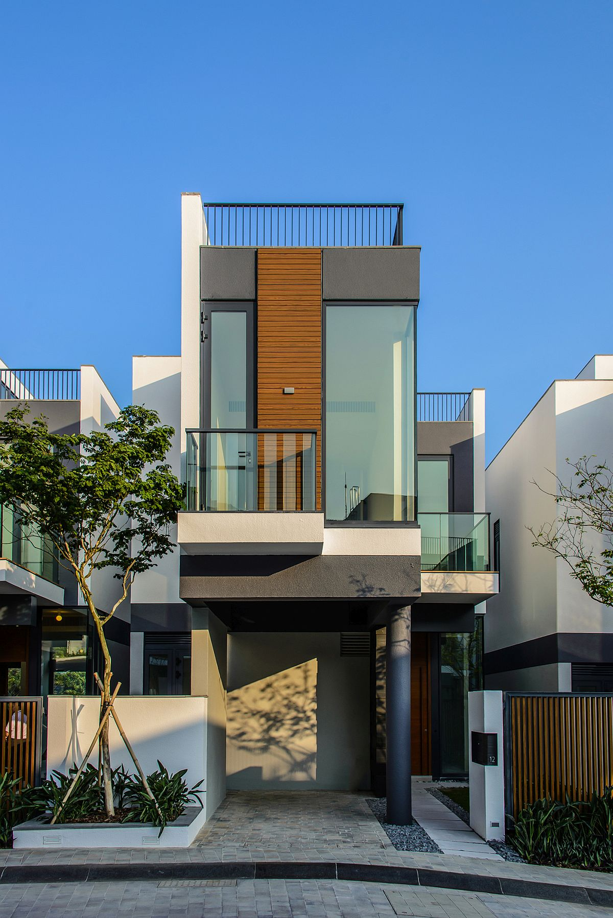 Street facade of Whitesands Home with a view of South China Sea