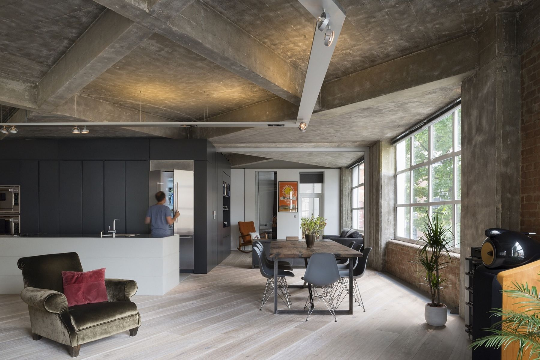 Stunningly transformed London loft draped in concrete and metal