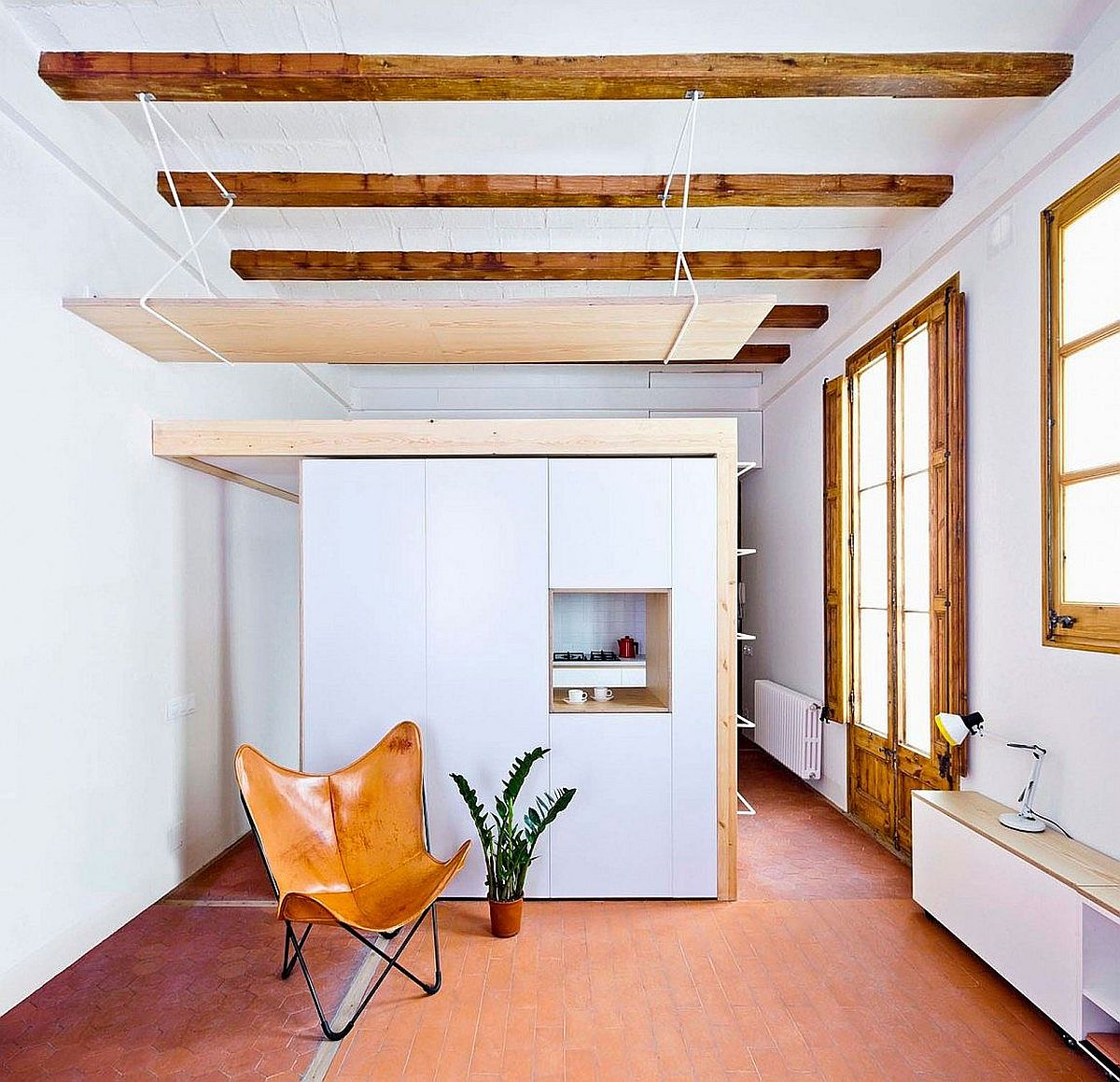 This tiny apartment kitchen has a mezzanine level of its own