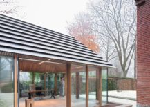 Tiny-Office-Pavilion-Vught-sits-next-to-a-classic-Dutch-home-with-red-brick-exterior-217x155