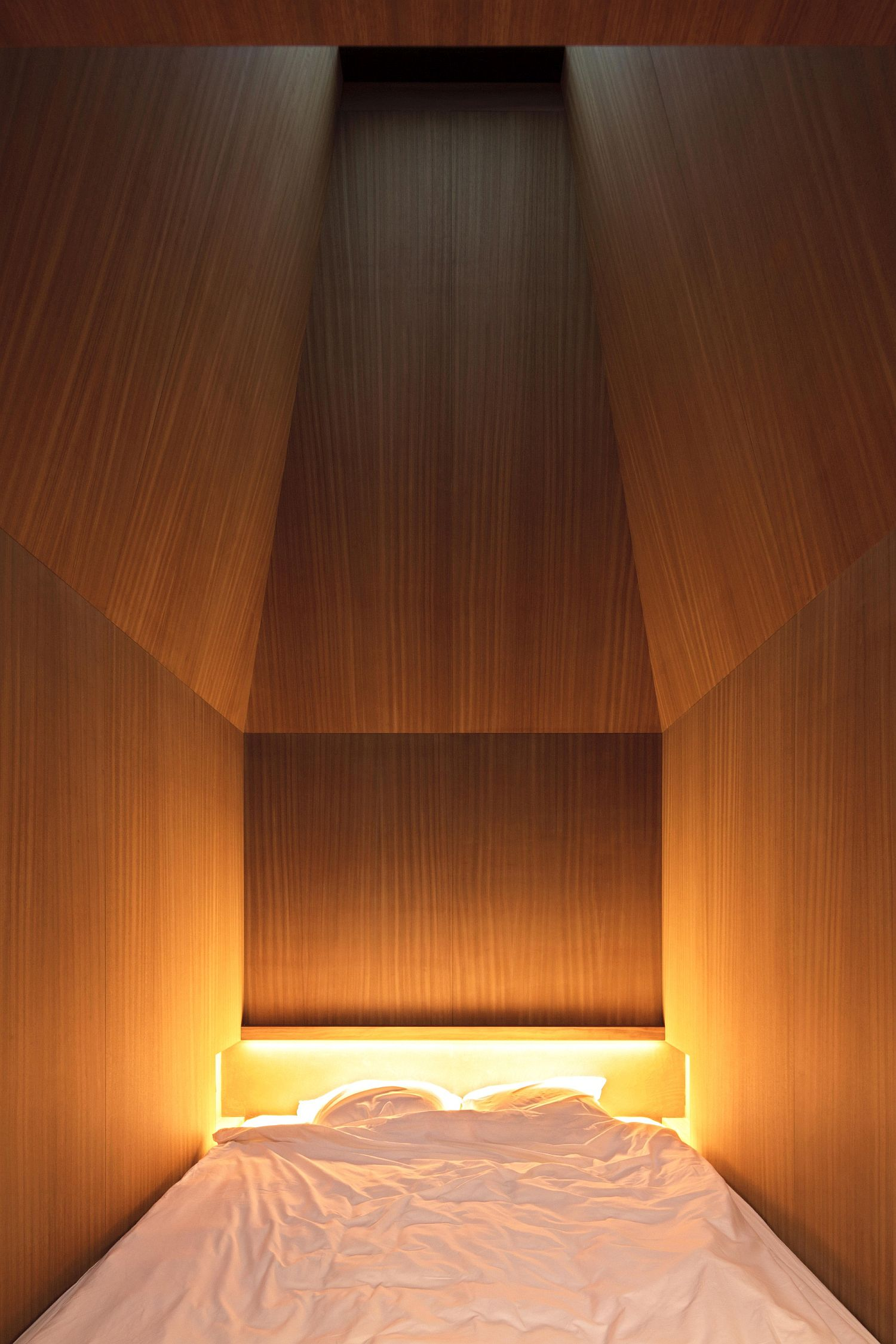 Tiny bedroom lit beautifully inside the office
