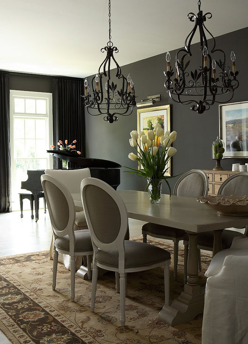Transitional dining room with twin black chandeliers