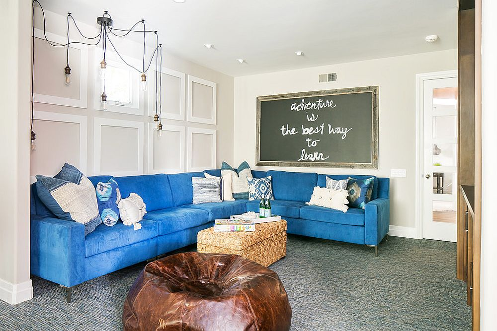 Transitional kids' room with a plush blue couch
