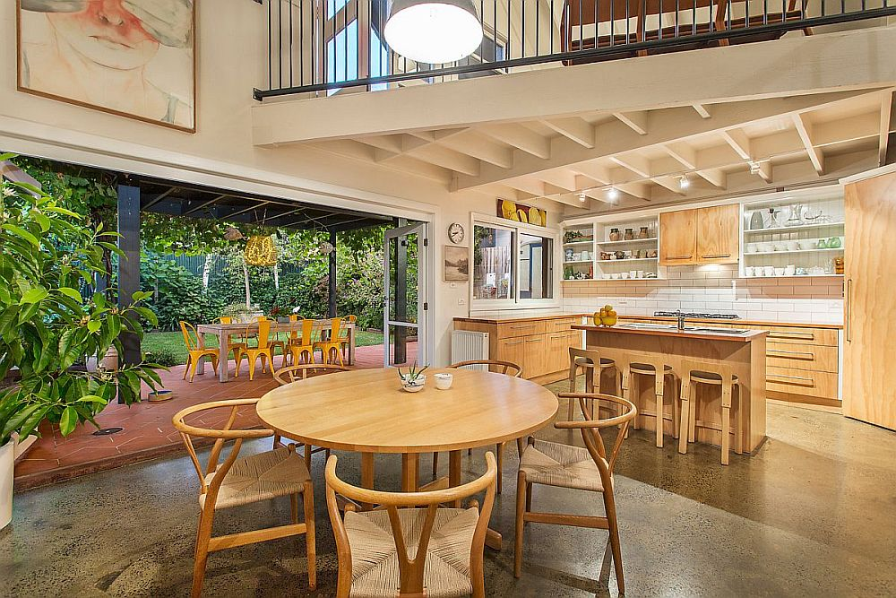 Warehouse turned into home with a high roof allows for the design of a kitchen under the mezzanine