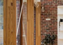 Wooden-beams-delineate-the-interior-from-the-pavilion-style-outdoors-217x155