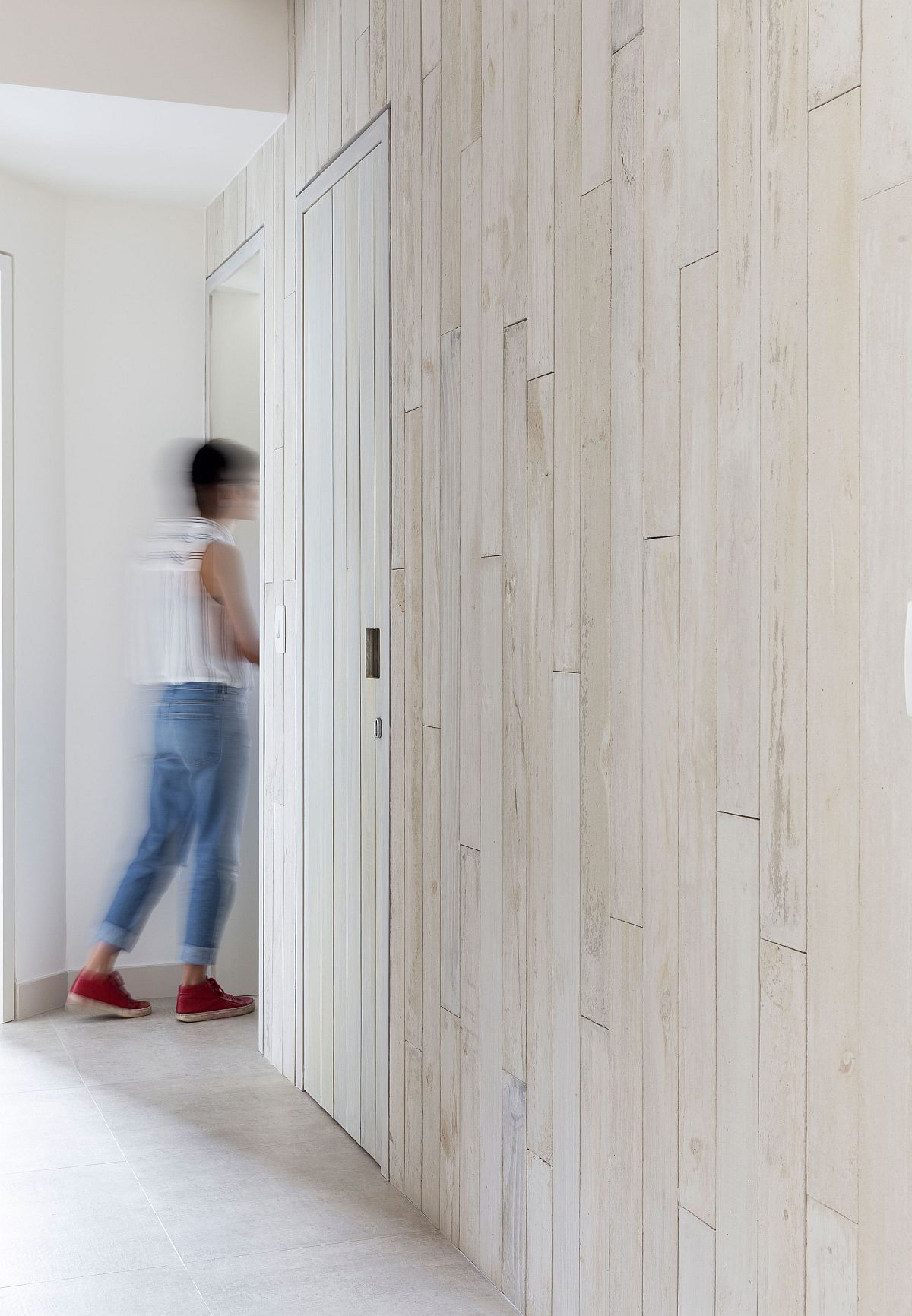 Wooden slats on the walls give the interior warm ad inviting glow