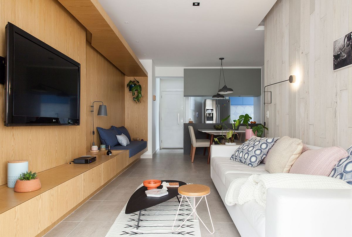 Wooden wall in the living room makes a bold visual impact