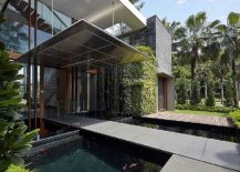 Bridge-above-the-koi-pond-acts-as-entrance-to-the-contemporary-home-217x155
