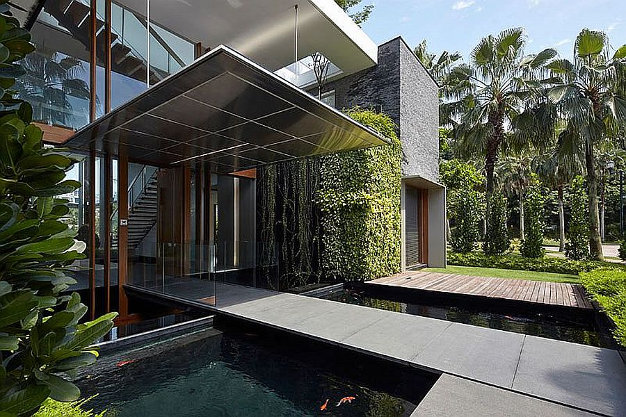 Bridge above the koi pond acts as entrance to the contemporary home