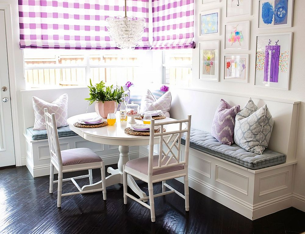 Brilliant pops of purple and violet enliven the small dining area