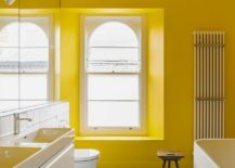 Contemporary-bathroom-in-yellow-and-white-with-ample-natural-ventilation-217x155