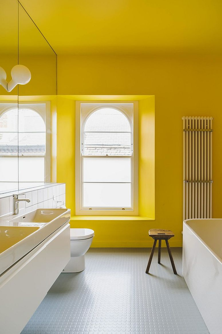 Contemporary bathroom in yellow and white with ample natural ventilation