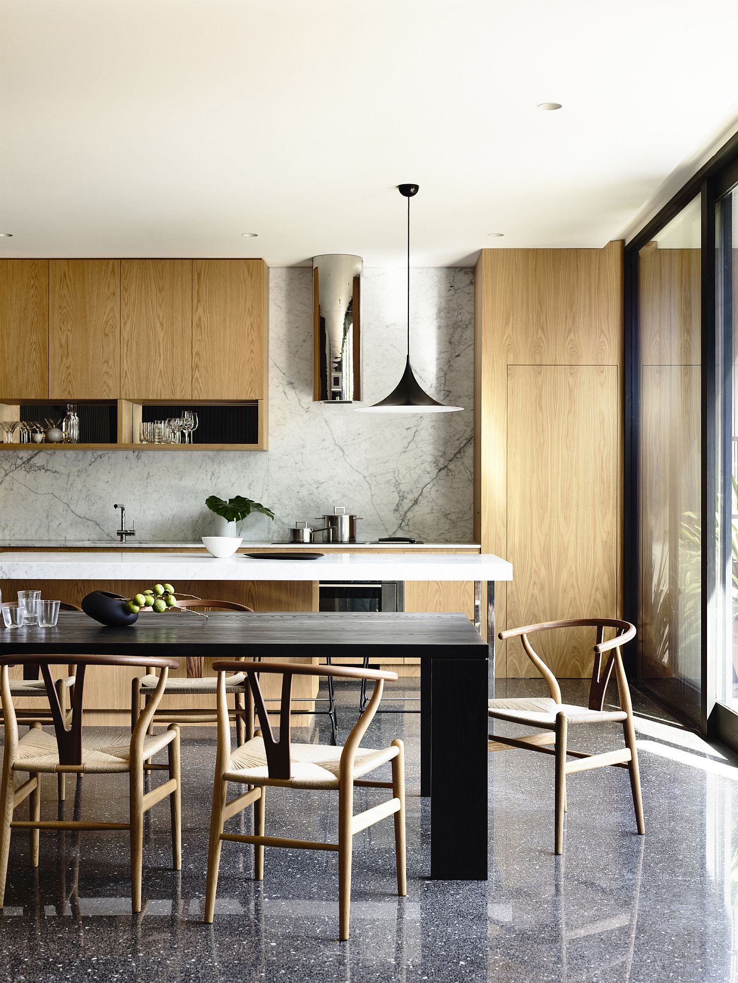 Contemporary kitchen with marble backsplash and wooden cabinets
