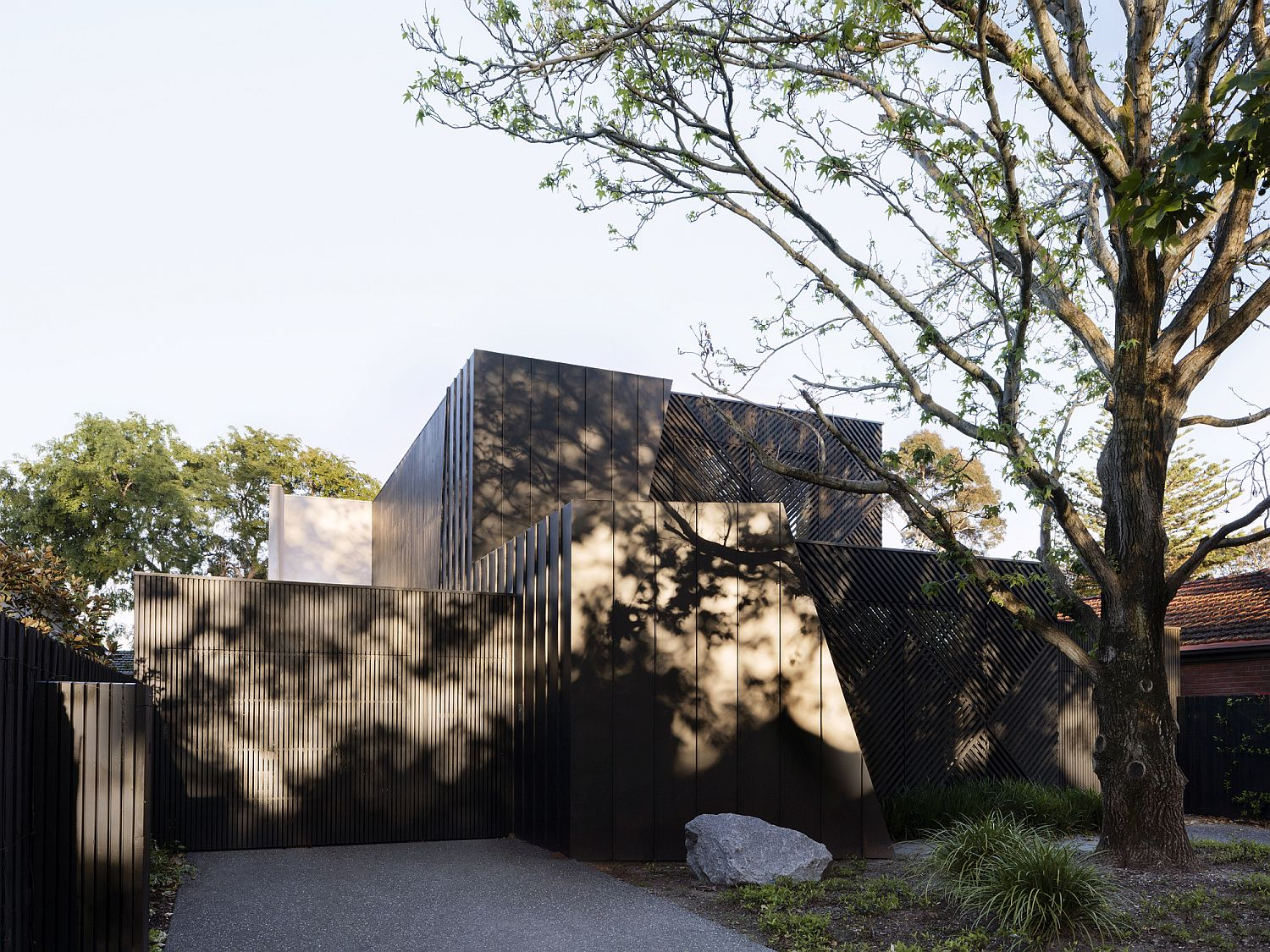 Dark and dashing street facade of the revamped 1970's Aussie home