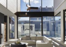 Dark-metallic-frame-glass-windows-and-a-wooden-roof-give-the-interior-a-unique-look-217x155