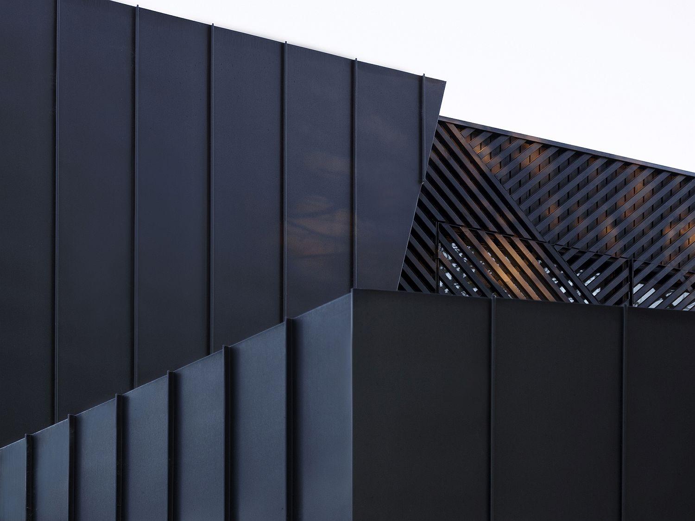 Dark zinc cladding and timber batten exterior of the Aussie home