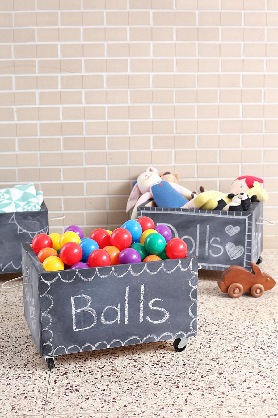 Easy to make DIY chalkboard toy boxes on wheels