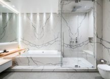 Even-a-hint-of-wood-brings-warmth-to-the-contemporary-minimal-bathroom-covered-in-marble-217x155