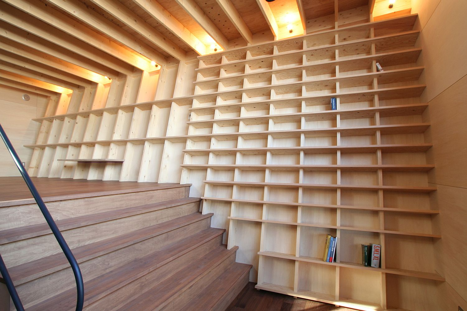 Giant bookshelf wall goes beyond the mundane