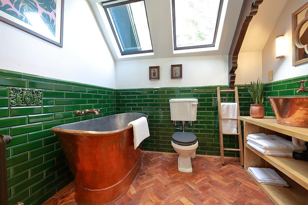 Ingenious and vintage bathroom with smart use of green and a copper bathtub
