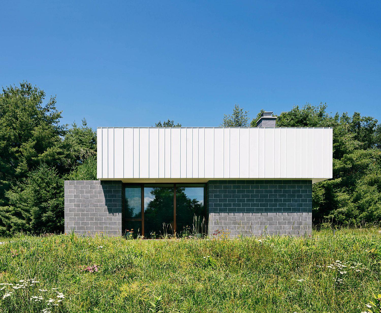 Lush green landscape around the contemporary Catskills House