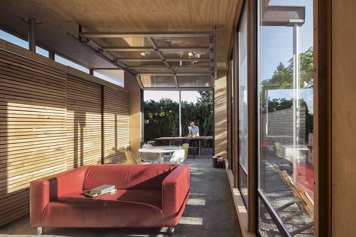 Natural light finds its way into the social zone of the pavilion style space