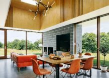 Open-and-inviting-double-height-living-and-dining-area-with-the-upper-level-decked-in-wood-217x155