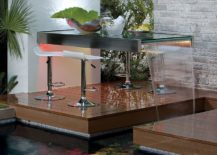 Outdoor-dining-table-along-with-a-water-feature-217x155