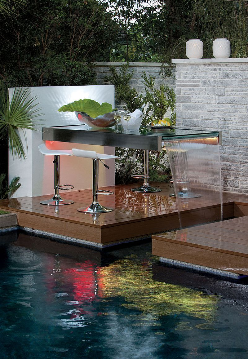 Outdoor dining table along with a water feature