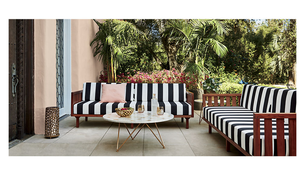 Pink cushion on striped outdoor seating