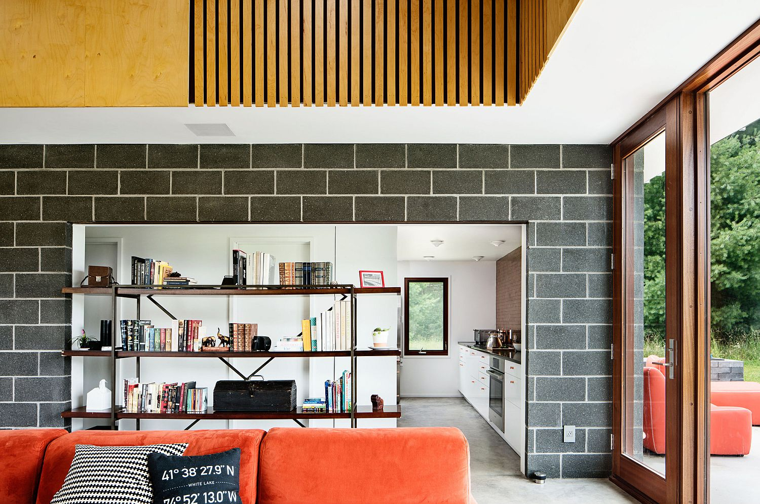 Pops of orange and industrial elements shine throughout the house