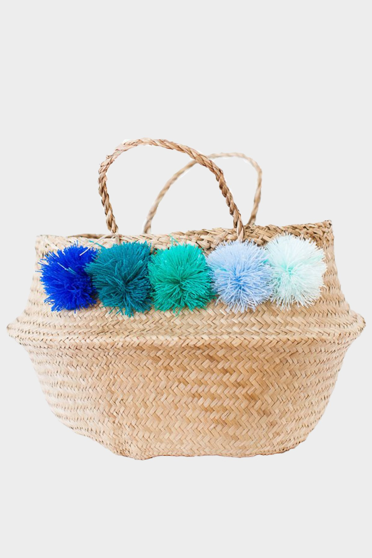 Seagrass-basket-with-blue-and-teal-pom-poms