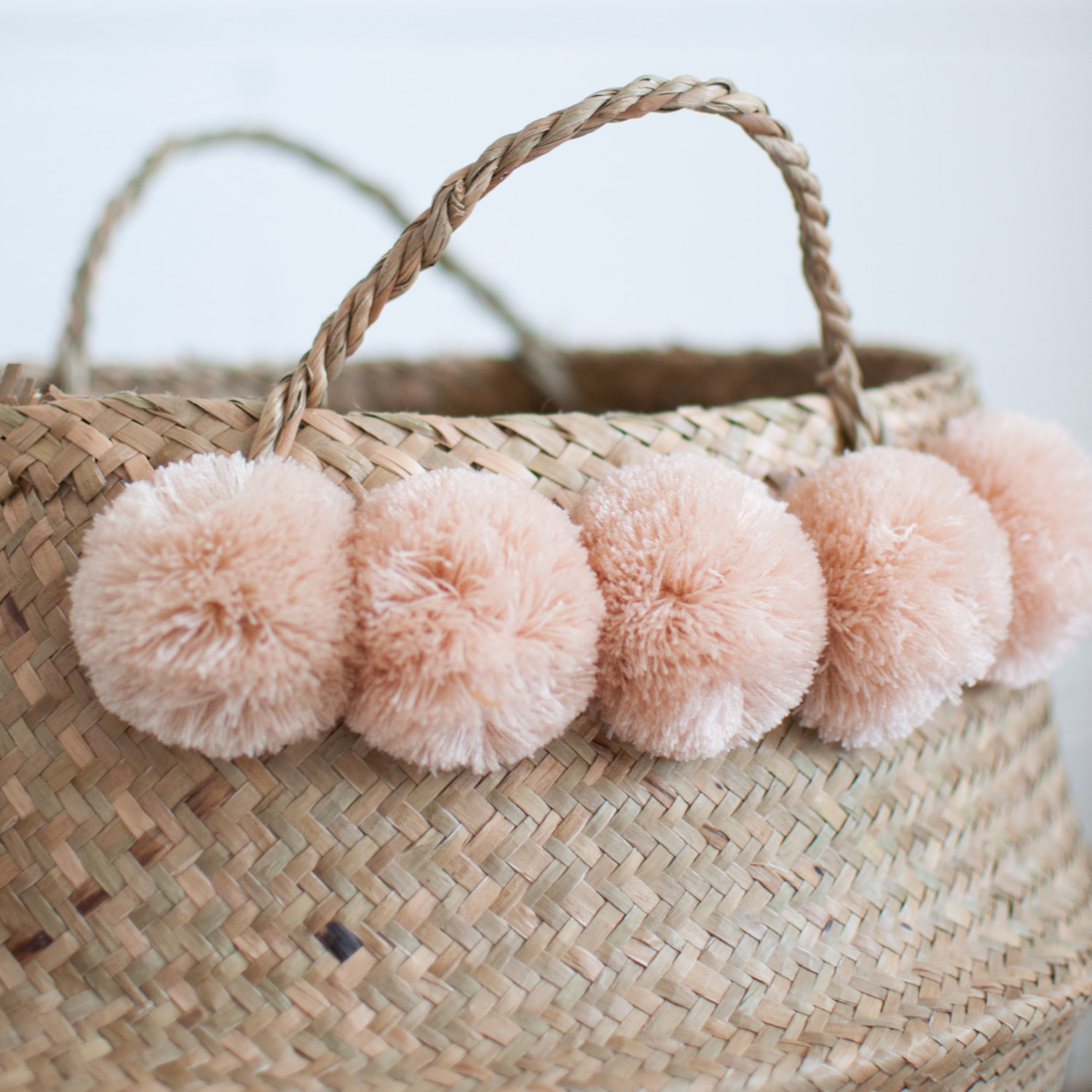 Seagrass basket with blush pom poms from Xinh & Co.
