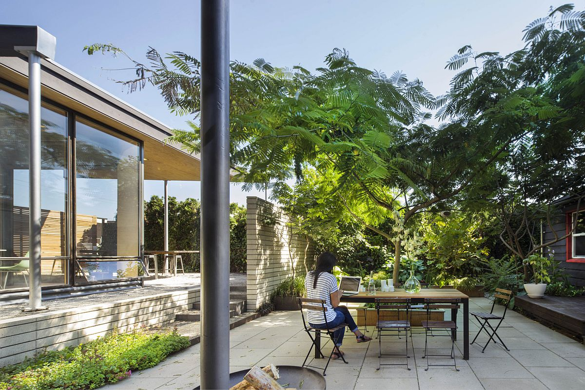 Silk tree and natural canopy gives the home plenty of shade