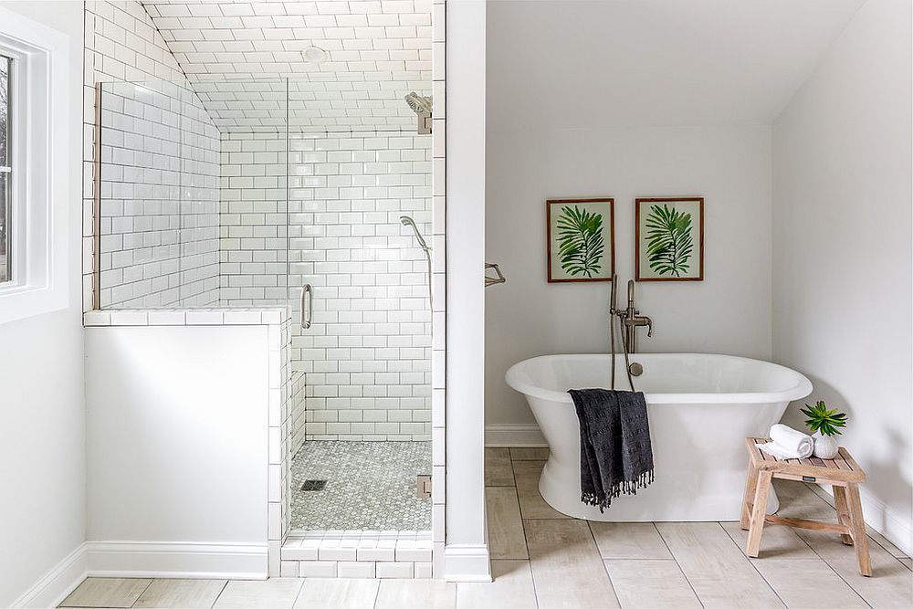 Simple pops of green shine through in the beach style bathroom in white